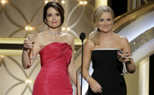 Tina and Amy drinkng Golden Globes
