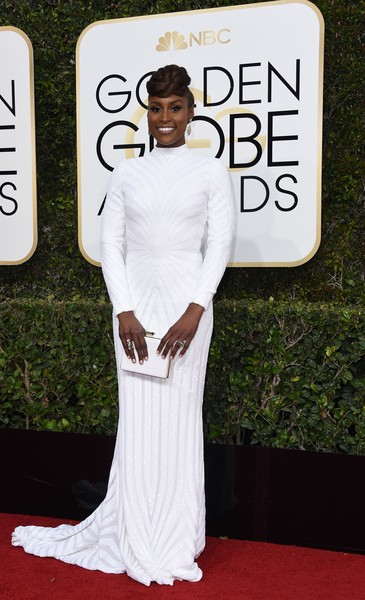 b5cc262d87b Issa Rae looks incredible in a long sleeve custom Christian Siriano  this  is how you do white to an awards show without coming across bridal. ...